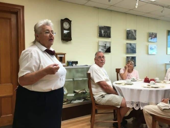 Carolyn Newman, a docent at the Roosevelt Campobello International Park, talks about Eleanor at the tea.