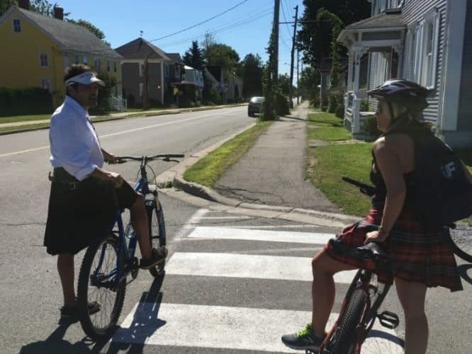 Biking the streets of St Andrews in kilts with Off Kilter Bike Tours.