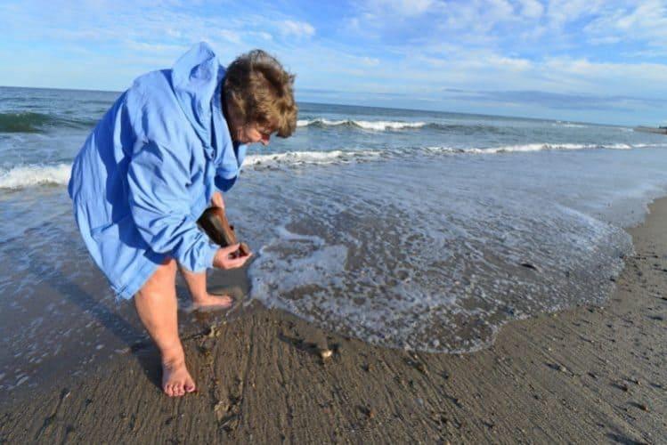 Mom enjoys hunting for shiny pebbles on the sandy shoreline of Nauset Beach. Sunrises are especially beautiful.