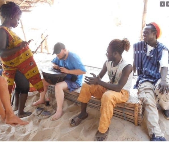 In the small village, Tony learns to play music with the locals.