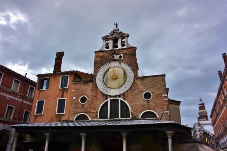 A 24 hour clock tower near the Rialto Bridge in Venice