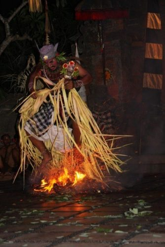 Doing a fire dance in the village of Batu Bulan