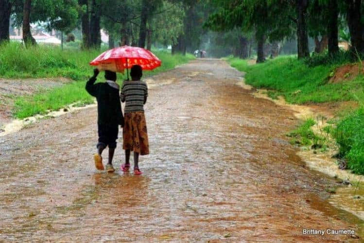 Children wading through the puddles on their way to Livingstonia town.