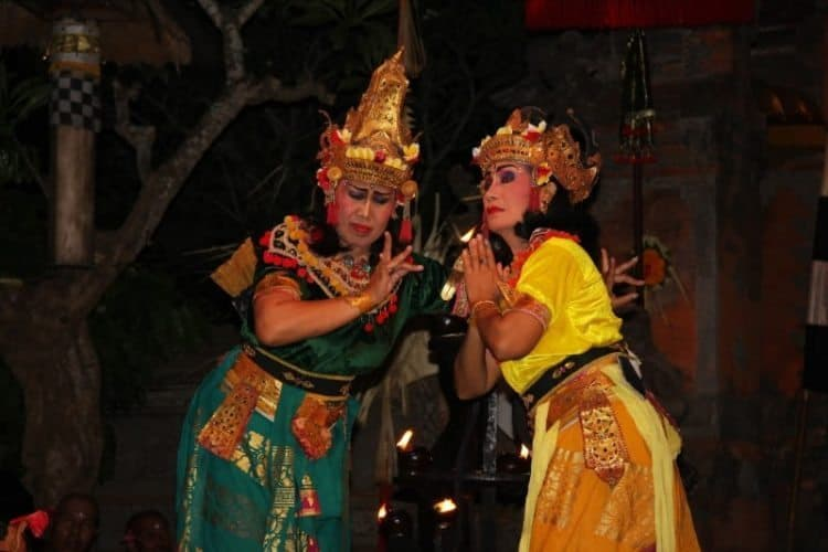 Balinese women dancing in the village of Batu Bulan, Bali.