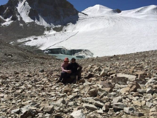 The highest elevation of the trip, Uween e Sar Pass at 4887 meters. Bernadine and Anna taking a well-earned rest after the challenging walk to the top.