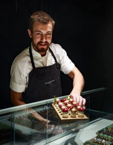 Craig Alibone presenting his mushroom chocolates.