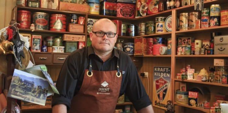 Svein Berfjord of Berg Gard Farm, Norway, in his farm shop/deli.