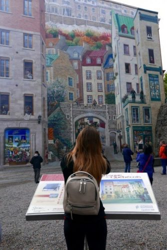 Admiring a large mural in downtown Quebec City.