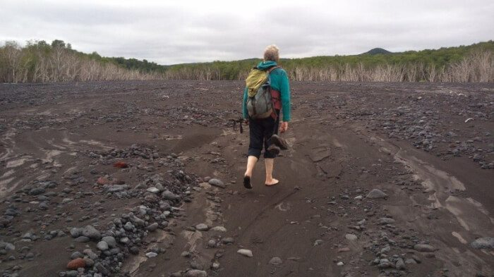 Sergey leads the way across the stony riverbed in Kamchatka, Russia.