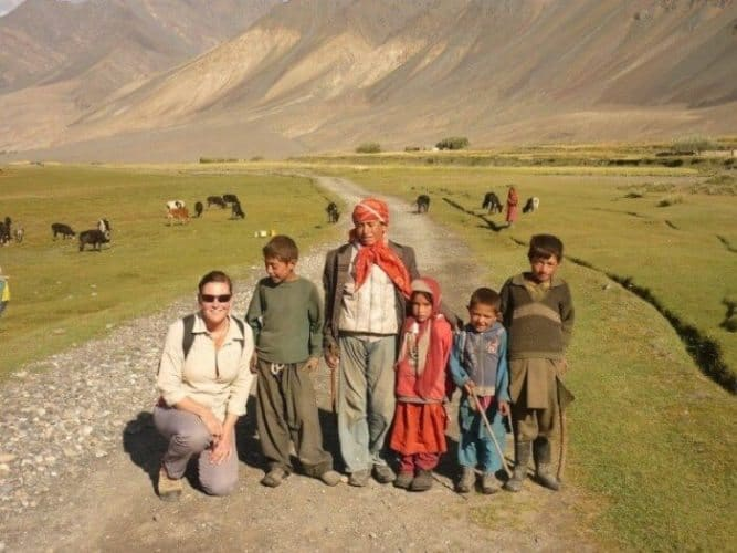 The end of the road, and the start of the two-week trek, the author at Sarhad e Broghil, being farewelled by the local Wakhi children.