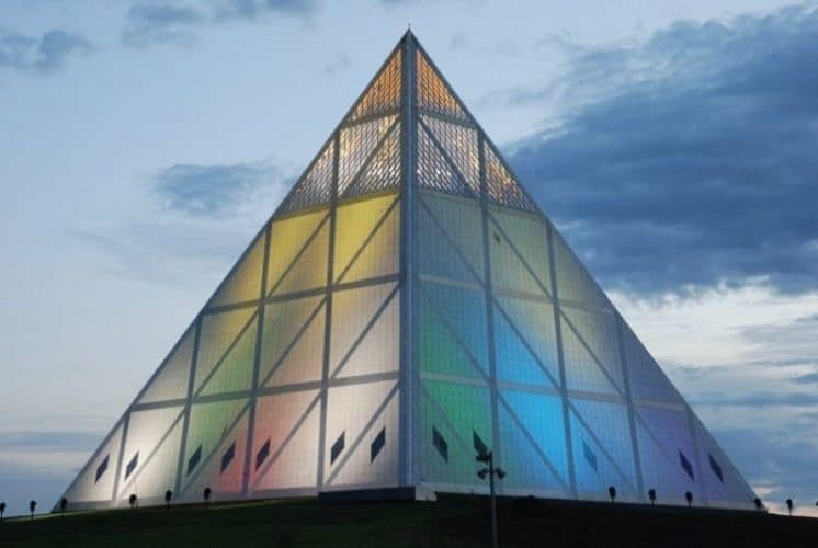 The pyramid's triangles are made out of granite, and a glazed apex which can be seen on top.