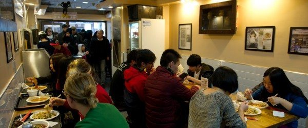 Inside of Nom Wah Tea Parlor with hungry patrons!
