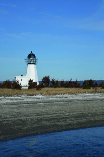 Sandy Point lighthouse and shore. The quality of the beach likely influenced the name of the jutting piece of land.