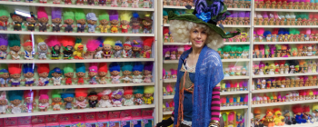 "Sigrid, the ""Troll Queen,"" in front of a collection troll dolls in Ohio"