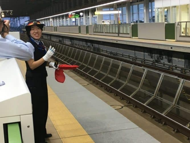 Barriers protect passengers against the high speed bullet trains that pass by, this is a station in Kyoto.
