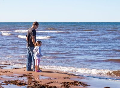 father and daughter on the beach in PEI