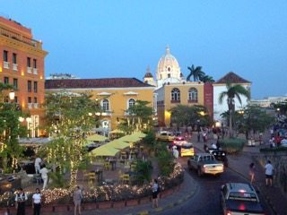 The city is very colorful, with bright orange and yellow walls everywhere. Plaza De Santa Teresa, Cartagena.
