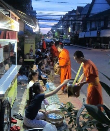 On many streets, early in the morning, you'll see these monks.
