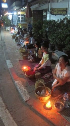 Monks lining the streets of Vientiane, Laos.