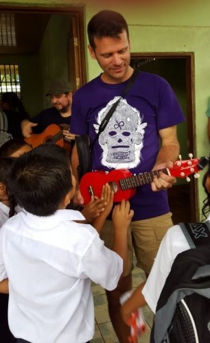 Isaiah shares some music with the school children, part of our Intercambio.