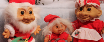 Some troll dolls dressed up for Christmas