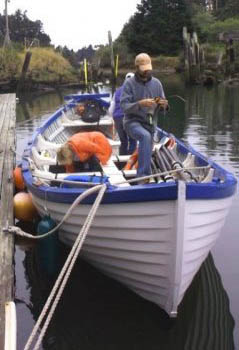 Coxswain, Jason Island and crew preparing the Helen Dee for a rowing trip. Dolphin Isle Marina, Fort Bragg CA.