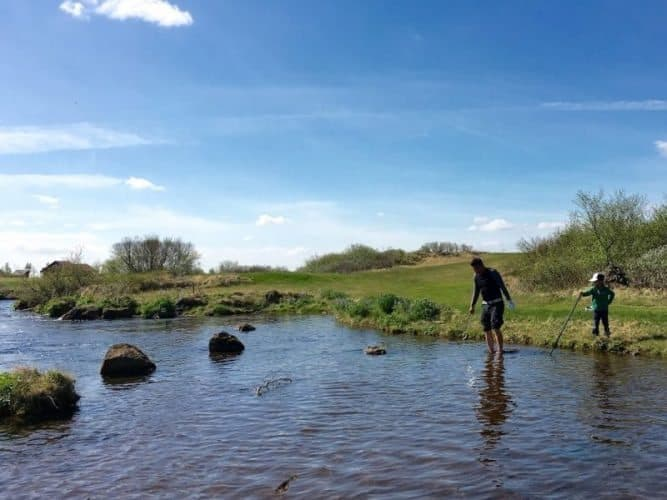 After losing all of his balls in the scrubby grasses of the Geysir Golf Course, a golfer braves ice-cold water to rescue a ball long surrendered by another golfer.