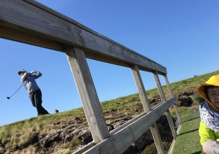 At the Grindavik Golf Course, a bridge helps golfers pass over a chasm in the earth where two tectonic plates are pulling away from each other. Golfers must tee off over the chasm.