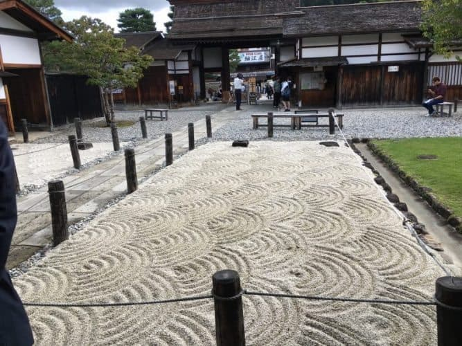 At the Takayama Jinya National Historic Site, which was a government office during the Edo era from 1692-1868, with perfectly raked gravel that matches the walls inside of the building.