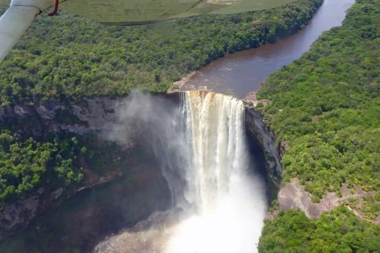 On departure day, the pilot flew over the huge waterfall.