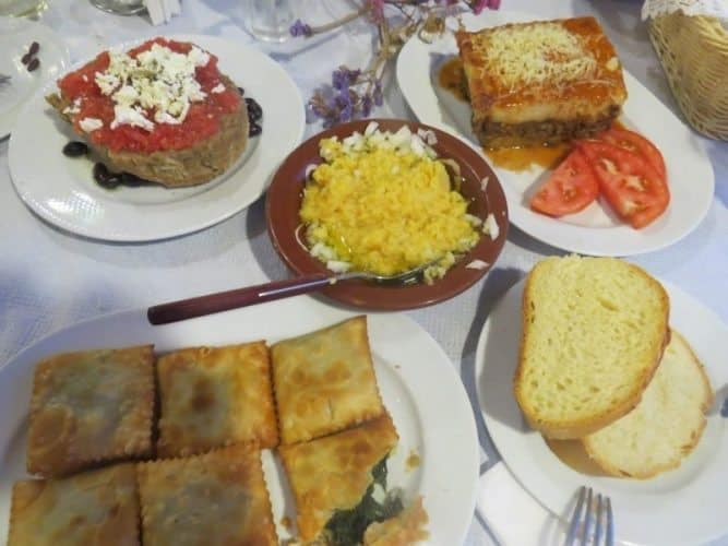 Assorted mezedes, including dakos, fava beans, moussaka and kalitsounia, pies filled with local greens in Crete.