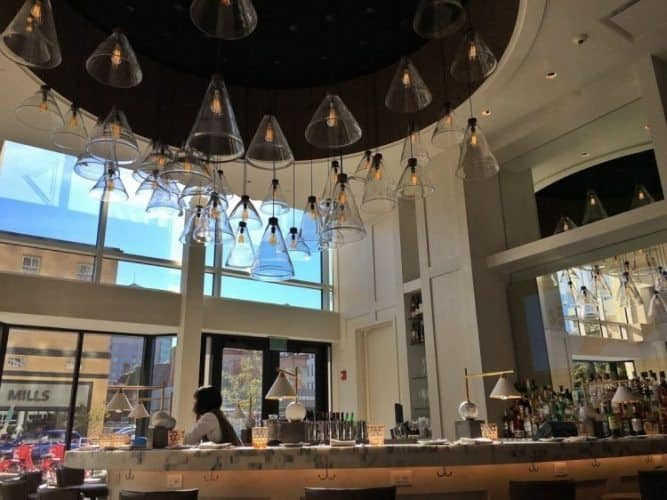 Patina 250 interiors, a sophisticated bar and modern light fixtures