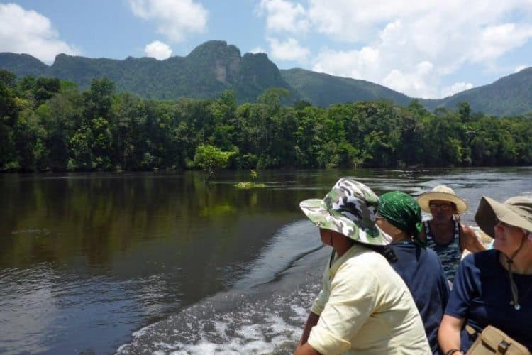 Cruising up the Potaro river amid plateaus and escarpments of solid rock jutting straight up from the forest floor near Kaieteur