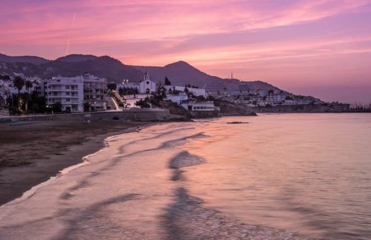 The whitewashed village of Sitges is a short drive from Barcelona and a lovely place to catch a break from big city life.