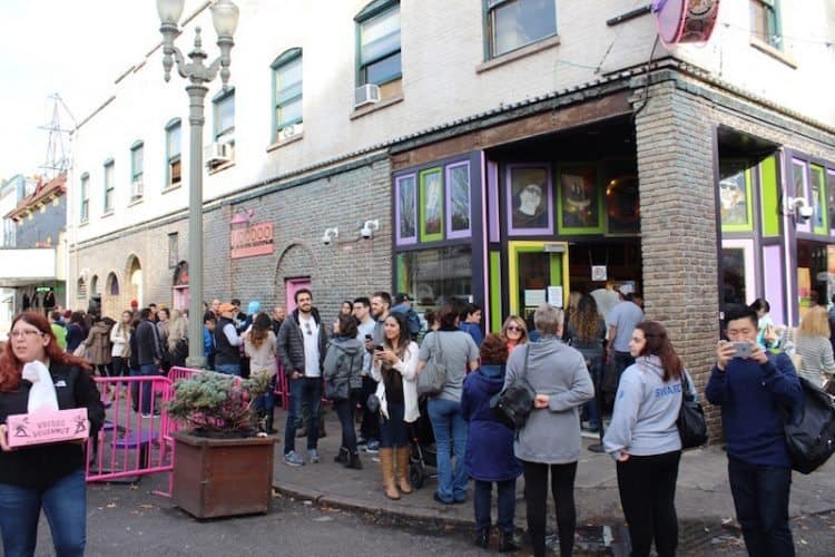 Long line at Voodoo Doughnuts