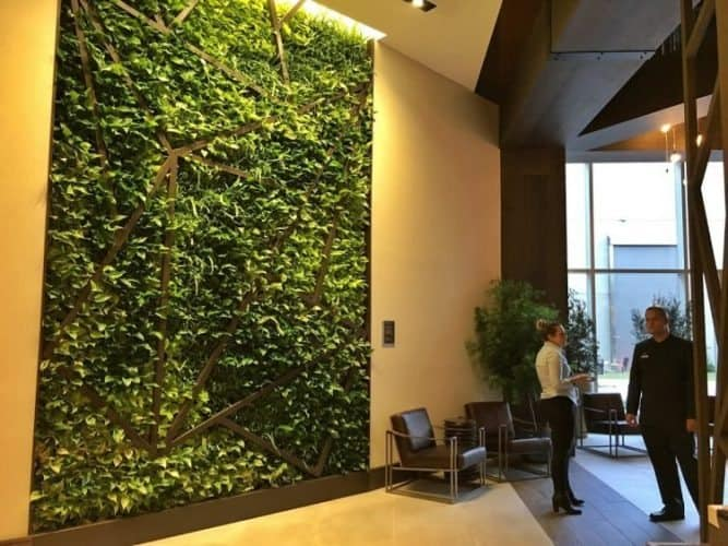 Westin interiors are sleek and modern with a touch of nature, like this living wall that adds lush greenery to the space.