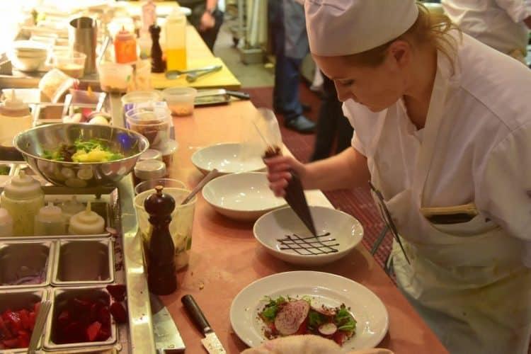 Chef and artist at work at Patina 250 kitchen, creating dessert