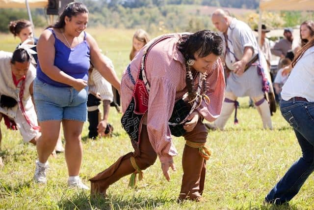 Cherokee Indians performing the Traditional Bear Dance with festival attendees participating