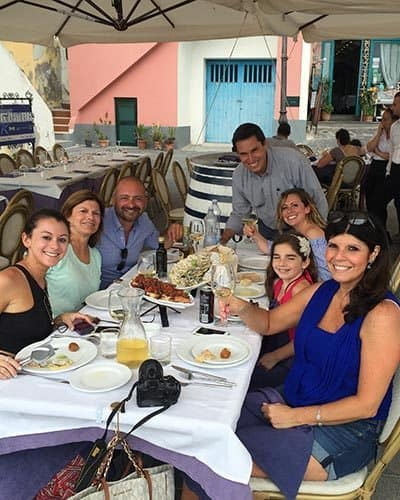 Women dining with local Mario on the Island of Procida. Photo by Travel Italian Style.
