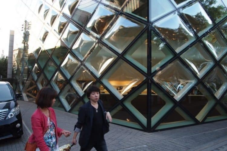 In the fashionable Omote Sando neighborhood, design stalwarts like Dior, shown here, and Stella McCartney have high end boutiques for affluent shoppers to browse in.