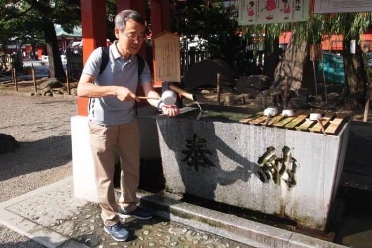 The ritual of handwashing with a special ladle is demonstrated at the Senso-Ji Temple at the Asakusa Shrine in Tokyo.