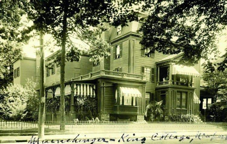 """As Time Goes By. c.1910. Photo post card of the Muenchinger-King House. Located on Bellevue across from The Reading Room. An advertisement in The Casino Bulletin of 1902 featured an ad for Muenchinger & Sons """"offering Lunches, Dinners, Receptions, Balls, Etc. Single Cooked Dishes to Order."""" Also offered were private accommodations by the day, week or season. Today this is an office building and residential condominiums."""