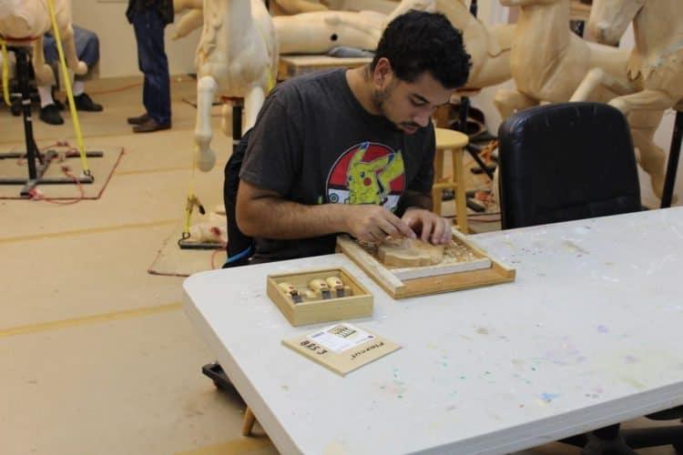 Apprentice carver on the Historic Carousel in Albany