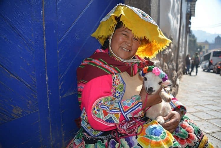 Some women in Cusco make their living posing for photos in native dress hugging pet lambs or llama. They are most grateful with whatever spare sol you can provide.