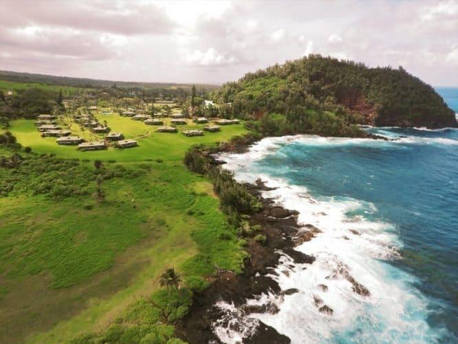 The Travaasa Hana sits next to a curve in the Hana shoreline on Maui, Hawaii.