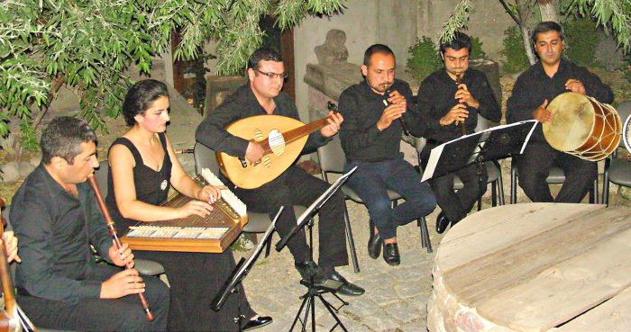World-touring Gurdjieff Ensemble in Villa Kars courtyard.