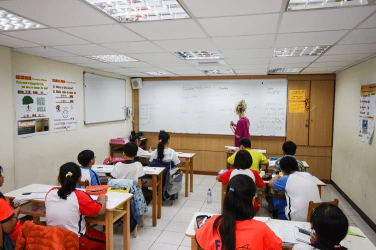 The author teaching English in a classroom in Taiwan. The real money, though, is in private tutoring, she says.