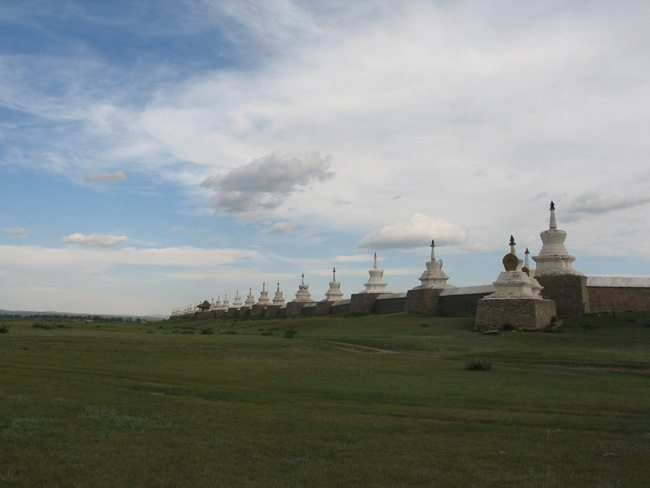 Stupas are spaced atop the wall surrounding Erdene Zuu Khiid. Mongolia