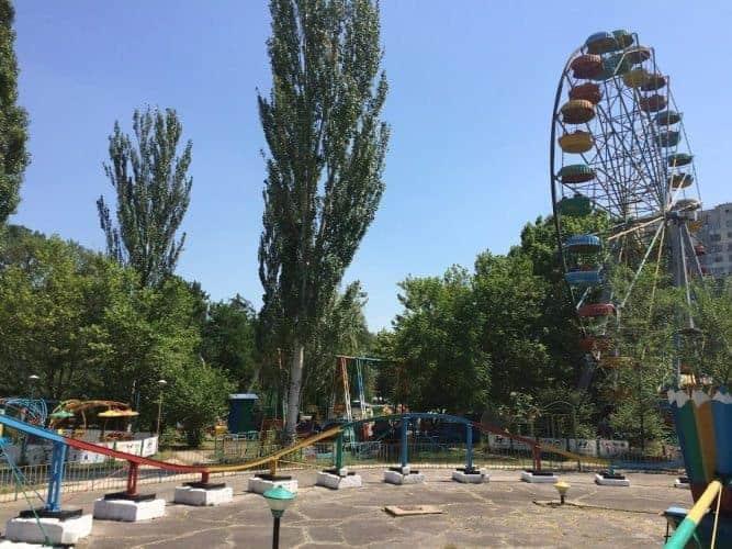Ferris Wheels and rollercoasters, outside of Chisinau, Moldova.