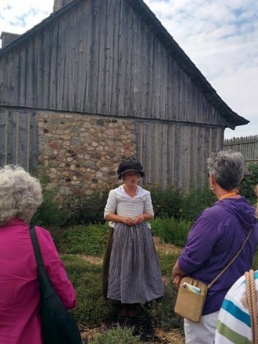 Re-enactor Fort Michilimackinac showing how early settlers grew gardens for their families.